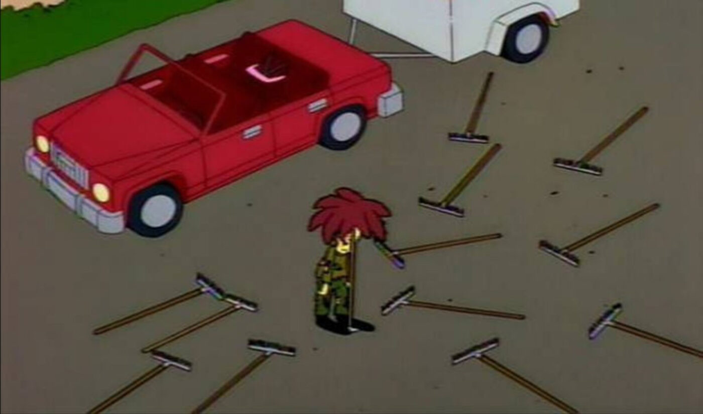 Sideshow Bob surrounded by rakes